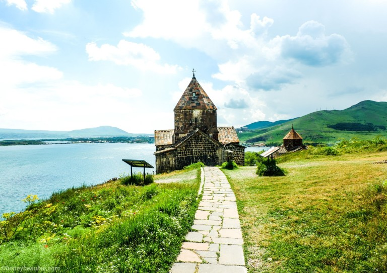 Landscape view of Sevanavank Monastery with Lake Sevan in the background.